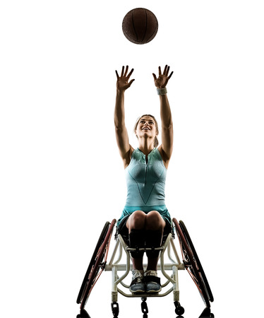 one caucasian young handicapped basket ball player woman in wheelchair sport tudio in silhouette isolated on white background Zdjęcie Seryjne