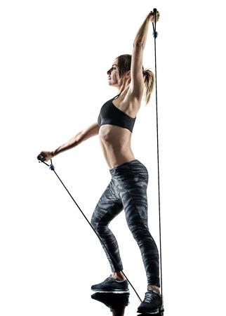 one caucasian woman exercising pilates fitness elastic resistant band exercises isolated silhouette on white background Reklamní fotografie - 99314731