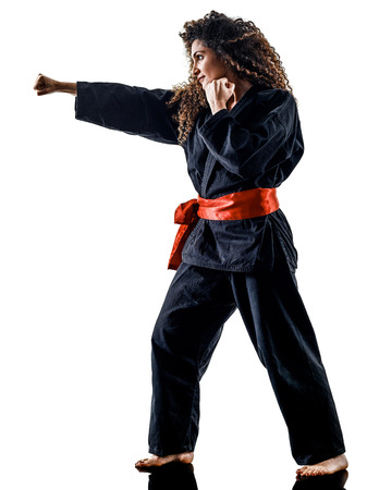 one caucasian woman practicing martial arts Kung Fu Pencak Silat in studio isolated on white background Foto de archivo