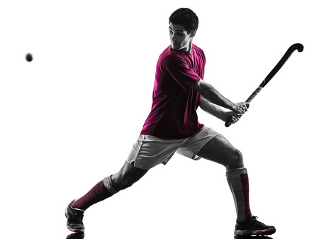 A Caucasian male field hockey player isolated on white background