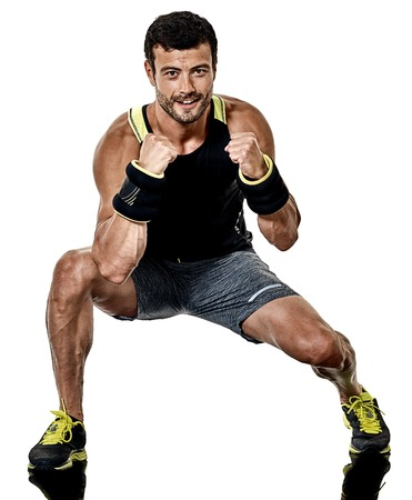 one caucasian fitness man exercising cardio boxing exercises in studio isolated on white background 写真素材 - 102666939