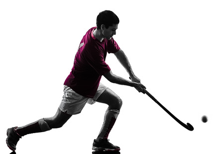 one caucasian field hockey player man isolated silhouette on white background Stockfoto