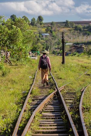 KALAW, MYANMAR - DECEMBER 06, 2016 : man local tribe walking on a railroad track near Kalaw Shan state in Myanmar (Burma) Editorial