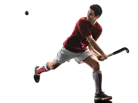 one caucasian field hockey player man isolated silhouette on white background Foto de archivo