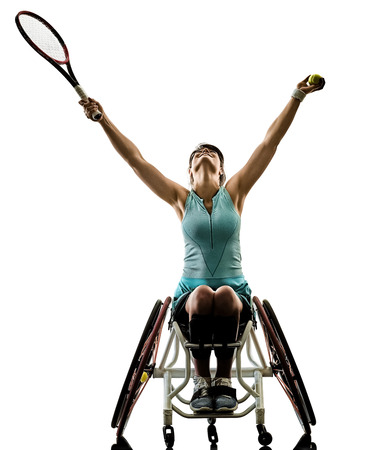 one caucasian young handicapped tennis player woman in welchair sport tudio in silhouette isolated on white background Reklamní fotografie