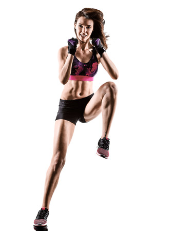 one caucasian woman exercising cardio boxing cross core workout fitness exercise aerobics silhouette isolated on white background 写真素材 - 105133667