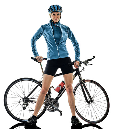 one caucasian cyclist woman cycling riding bicycle standing smiling isolated on white background 免版税图像