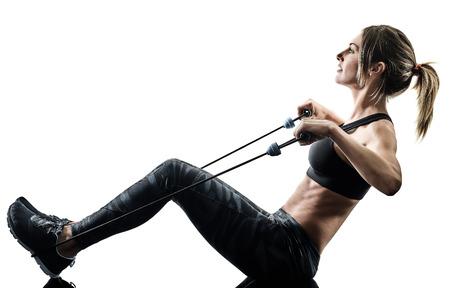 one caucasian woman exercising pilates fitness elastic resistant band exercises isolated silhouette on white background Reklamní fotografie - 115774518