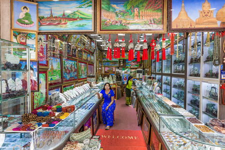 YANGON, MYANMAR -NOVEMBER 25, 2016 : people in shops stall of Bogyoke Aung San Market Yangon (Rangoon) in Myanmar (Burma) Editorial