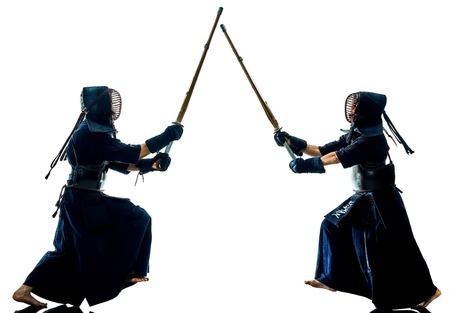 two Kendo martial arts fighters combat fighting in silhouette isolated on white bacground Stok Fotoğraf - 115774785