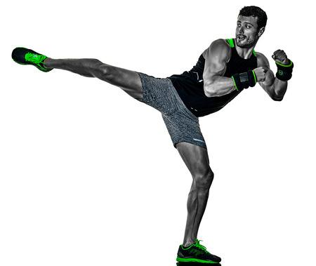 one caucasian fitness man exercising cardio boxing exercises in studio  isolated on white background 写真素材