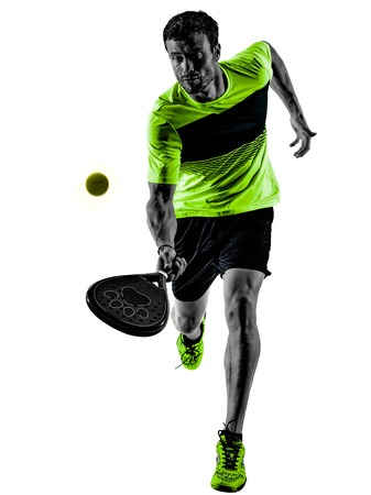one caucasian man playing PadDLe tennis player isolated on white background