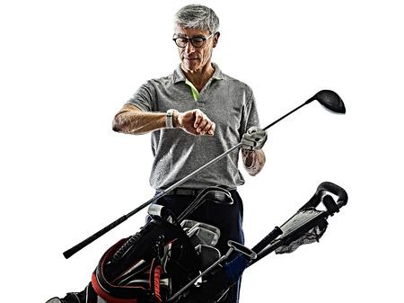 one caucasian senior man golfer golfing  in studio shadow silhouette isolated on white background 写真素材 - 121656487