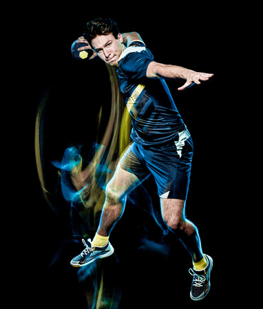 one caucasian handball player young man isolated on black background with speed light painting effect motion blur 写真素材