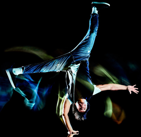 one chinese young man hip hop break dancer dancing isolated on black background with speed light painting effect motion blur Stok Fotoğraf
