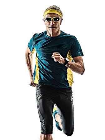 one caucasian senior man running runner jogger jogging  in studio shadow silhouette isolated on white background Banco de Imagens