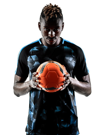 one african soccer player man playing in studio isolated on white background Фото со стока