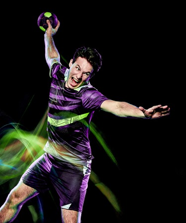 one caucasian handball player young man isolated on black background with speed light painting effect motion blur 版權商用圖片