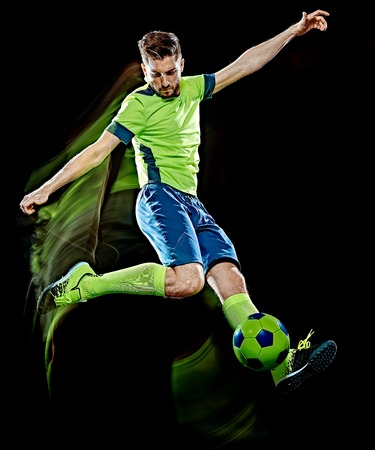 one caucasian soccer player man isolated on black background with light painting speed effect 版權商用圖片 - 119773812
