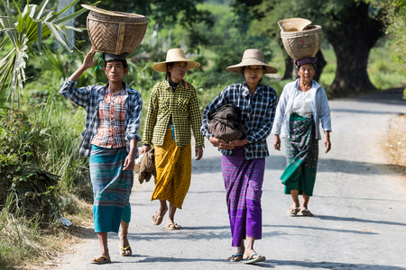 CHAUNG-U, MYANMAR - DECEMBER 01, 2016 :  burmesse farmers women walking on the road near Monywa Editorial