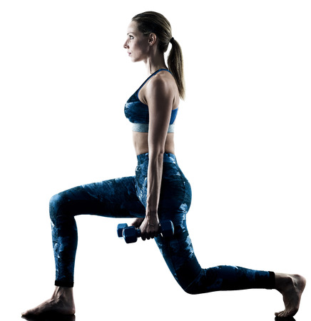 one caucasian woman exercising fitness weights excercises in silhouette isolated on white background Reklamní fotografie