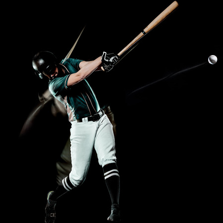 one caucasian baseball player man  studio shot isolated on black background with light painting speed effect Фото со стока