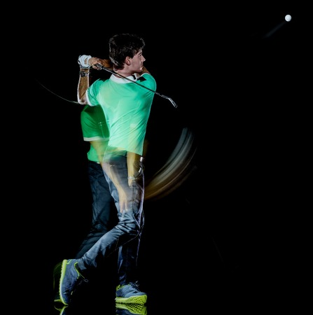 one caucasian young golfer man golfing golf swing isolated on black background with multiple exposure