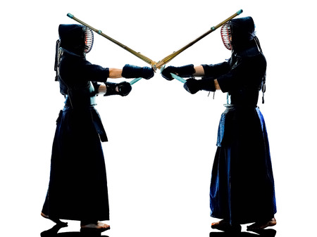 two Kendo martial arts fighters combat fighting in silhouette isolated on white bacground Stok Fotoğraf - 120855303