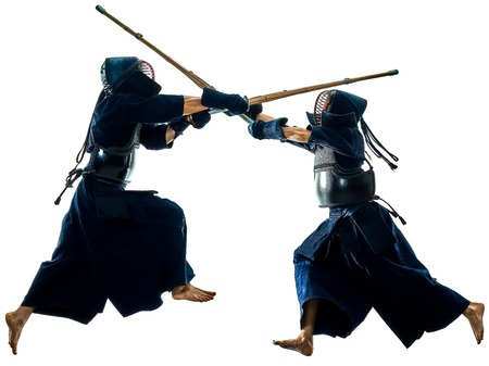 two Kendo martial arts fighters combat fighting in silhouette isolated on white bacground Stok Fotoğraf - 120855349