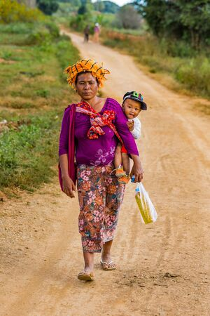 KALAW, MYANMAR - DECEMBER 07, 2016 : Shan tribe woman walking in tradional costume near Kalaw in Myanmar (Burma)