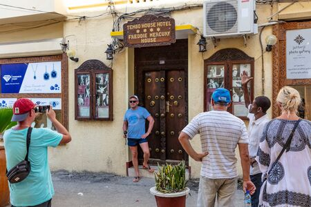 Stone Town , Zanzibar-February  28, 2019 : Tourists posing in front of freddie mercury house facade Editorial