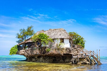 Pingwe , Zanzibar-March 7, 2019 : the Rock famous amazing location restaurant on the beach Editorial