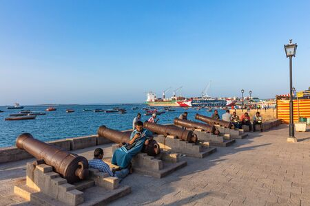 Stone Town , Zanzibar-February  28, 2019 : people enjoying the Stone Town waterfront promenade Editorial