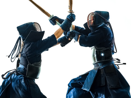 two Kendo martial arts fighters combat fighting in silhouette isolated on white bacground 写真素材 - 121655922