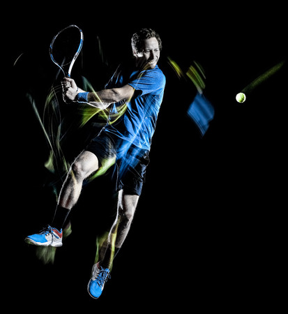one caucasian tennis player man isolated black background in light painting speed motion 写真素材