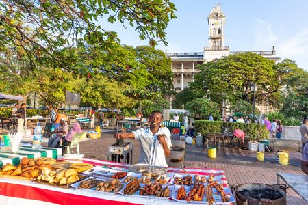 Stone Town , Zanzibar-February  28, 2019 : Man smiling serving street food in Forodhani Park