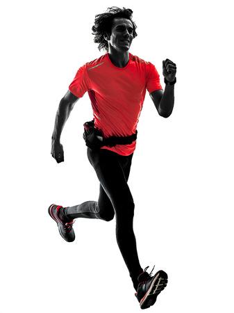 ein kaukasischer Mann, der den laufenden Rüttler des Läufers rüttelt im Studio-Schattenbild lokalisiert auf weißem Hintergrund pratcticing ist