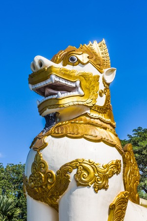 Chinthe statue  in front of the Shwedagon Pagoda at Yangon (Rangoon) in Myanmar (Burma)