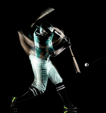 one caucasian baseball player man  studio shot isolated on black background with light painting speed effect Banco de Imagens