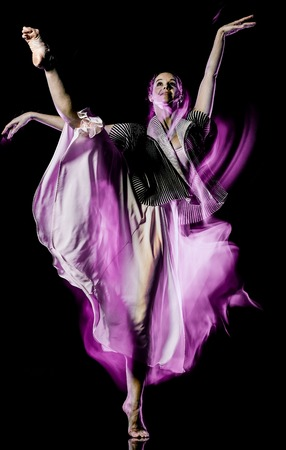 one caucasian woman modern ballet dancer dancing woman studio shot isolated on black bacground Stock Photo - 124989337