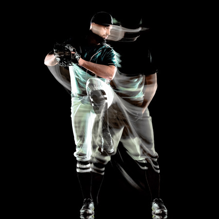 one caucasian baseball player man  studio shot isolated on black background with light painting speed effect Stock fotó