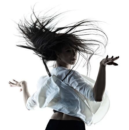 one young beautiful long hair caucasian woman modern ballet disco dancer dancing studio shot silhouette shadow isolated on white background Banco de Imagens - 124989791