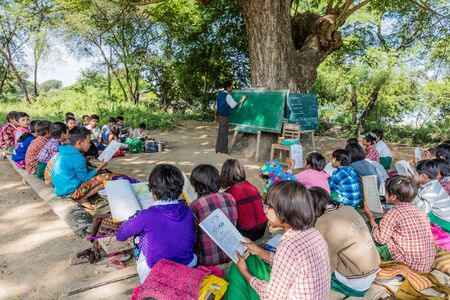 Chaung-U, Myanmar - December 01, 2016 : children at an outside clasroom school in Myanmar