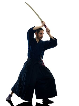 one caucasian man practicing laido Katori Shinto ryu isolated shadow silhouette white background Stock Photo - 125901567