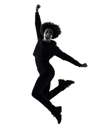 one mixed race african young teenager girl woman jumping happy in studio shadow silhouette isolated on white background Banco de Imagens