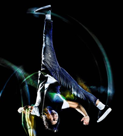 one chinese young man hip hop break dancer dancing isolated on black background with speed light painting effect motion blur Banco de Imagens - 128292352