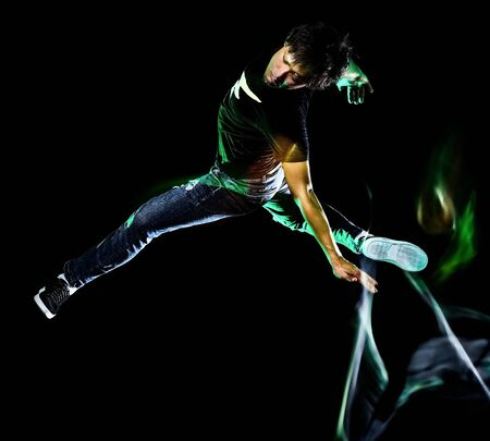 one chinese young man hip hop break dancer dancing isolated on black background with speed light painting effect motion blur Banco de Imagens
