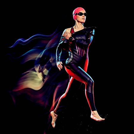 one caucasian woman triathlon triathlete studio shot isolated on black background with light painting effect
