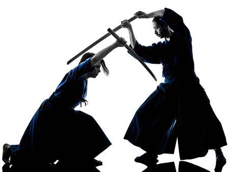 caucasian man and woman practicing laido Katori Shinto ryu isolated shadow silhouette on white background Stock Photo