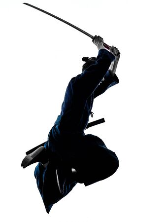 one caucasian man practicing laido Katori Shinto ryu isolated shadow silhouette white background Stock Photo